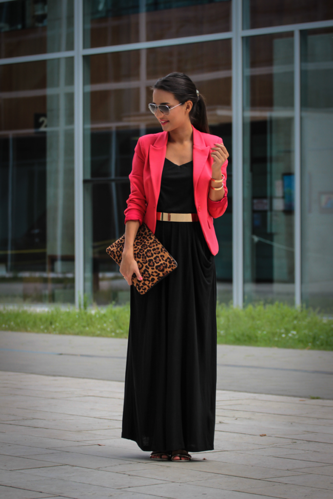 how to wear a maxi skirt: style a black maxi skirt with a belt and a blazer
