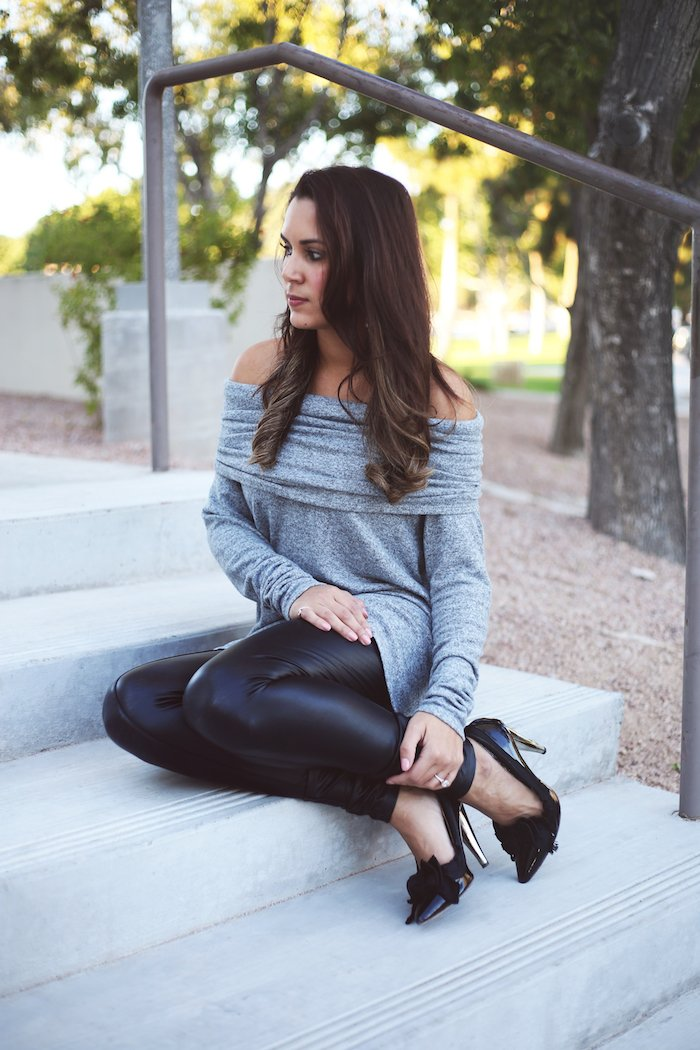 Cute and comfy thanksgiving outfit idea. Love this off-the-shoulder top and these stretchy faux leather leggings! See the rest of this post for even more Thanksgiving outfit ideas.