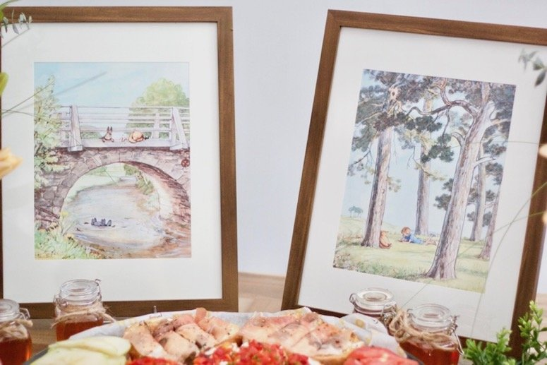 Classic Winnie the Pooh framed art for a Winnie the Pooh themed baby shower! Click to see even more of the decor and food ideas in the post