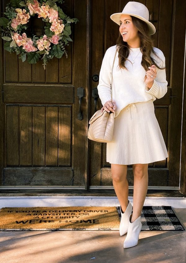 cream skirt with cream sweater and cream booties outfit ysl loulou bag
