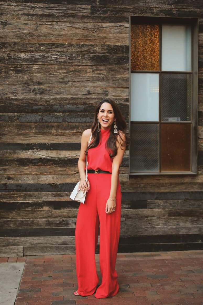 classy red halter jumpsuit with louis vuitton belt
