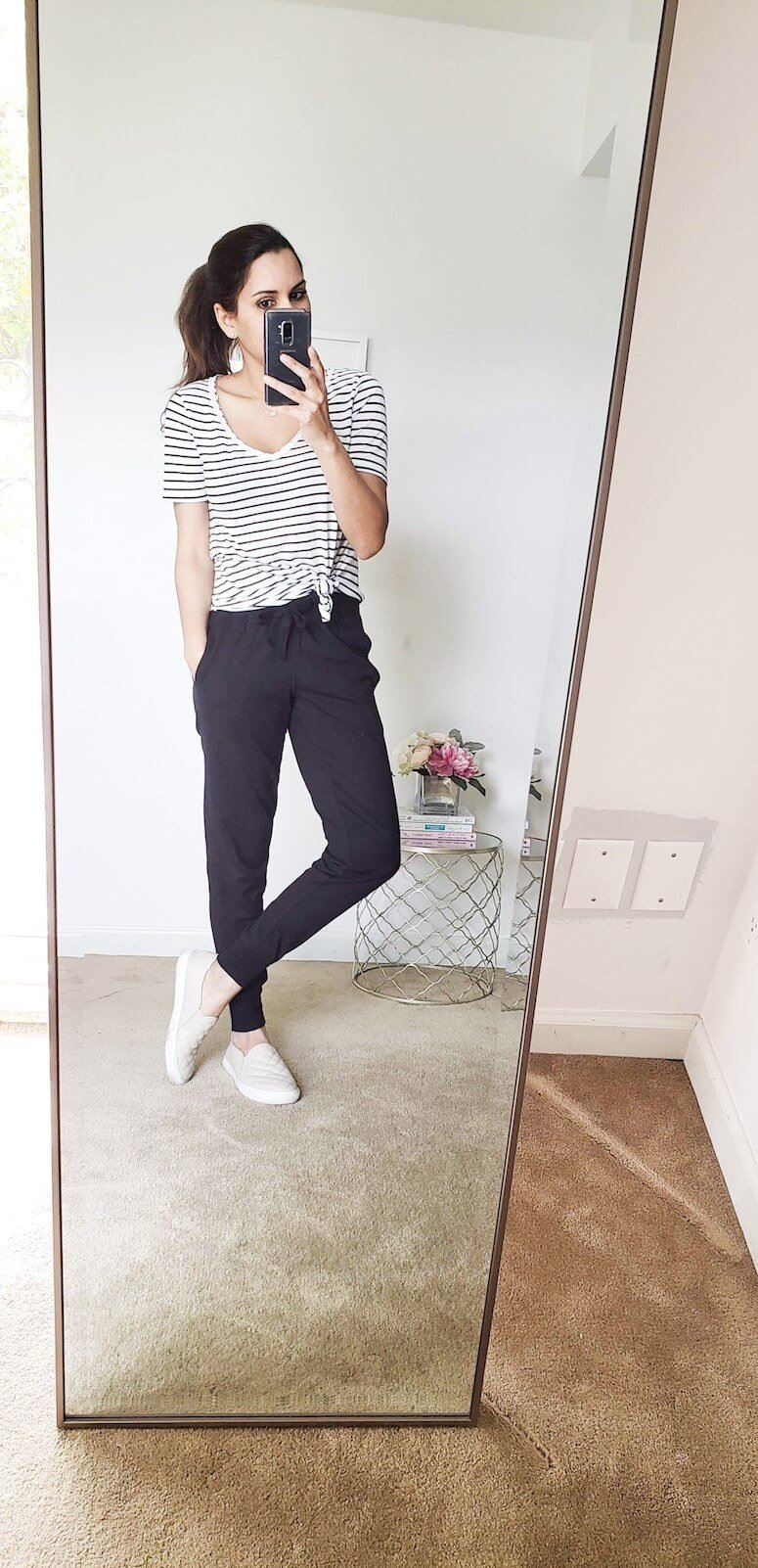 black joggers with t-shirt look. Try knotting your tee for a different style!