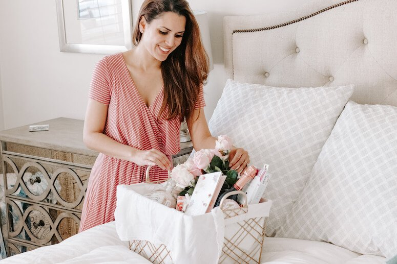 woman creating luxury Mother's Day gift basket
