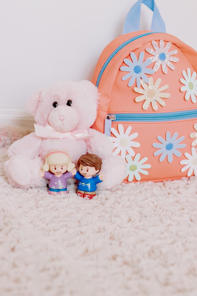 pink toddler backpack and toys