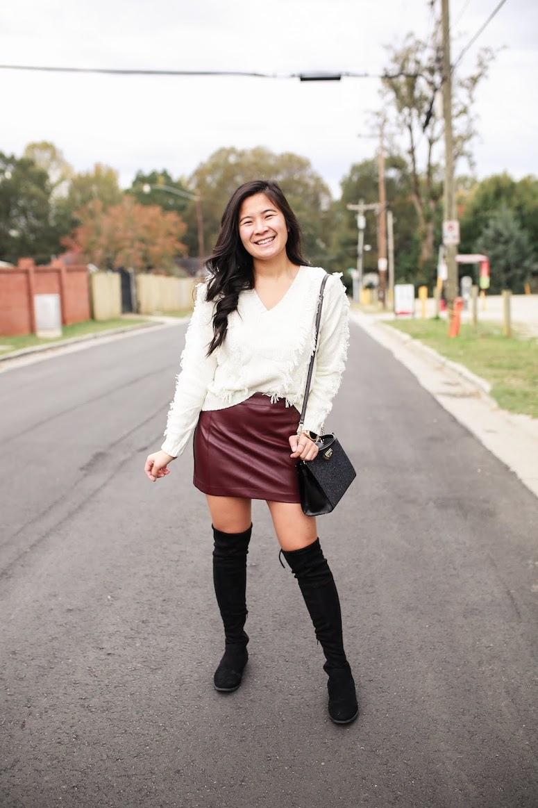 faux leather skirt outfit for fall-cute thanksgiving outfit ideas
