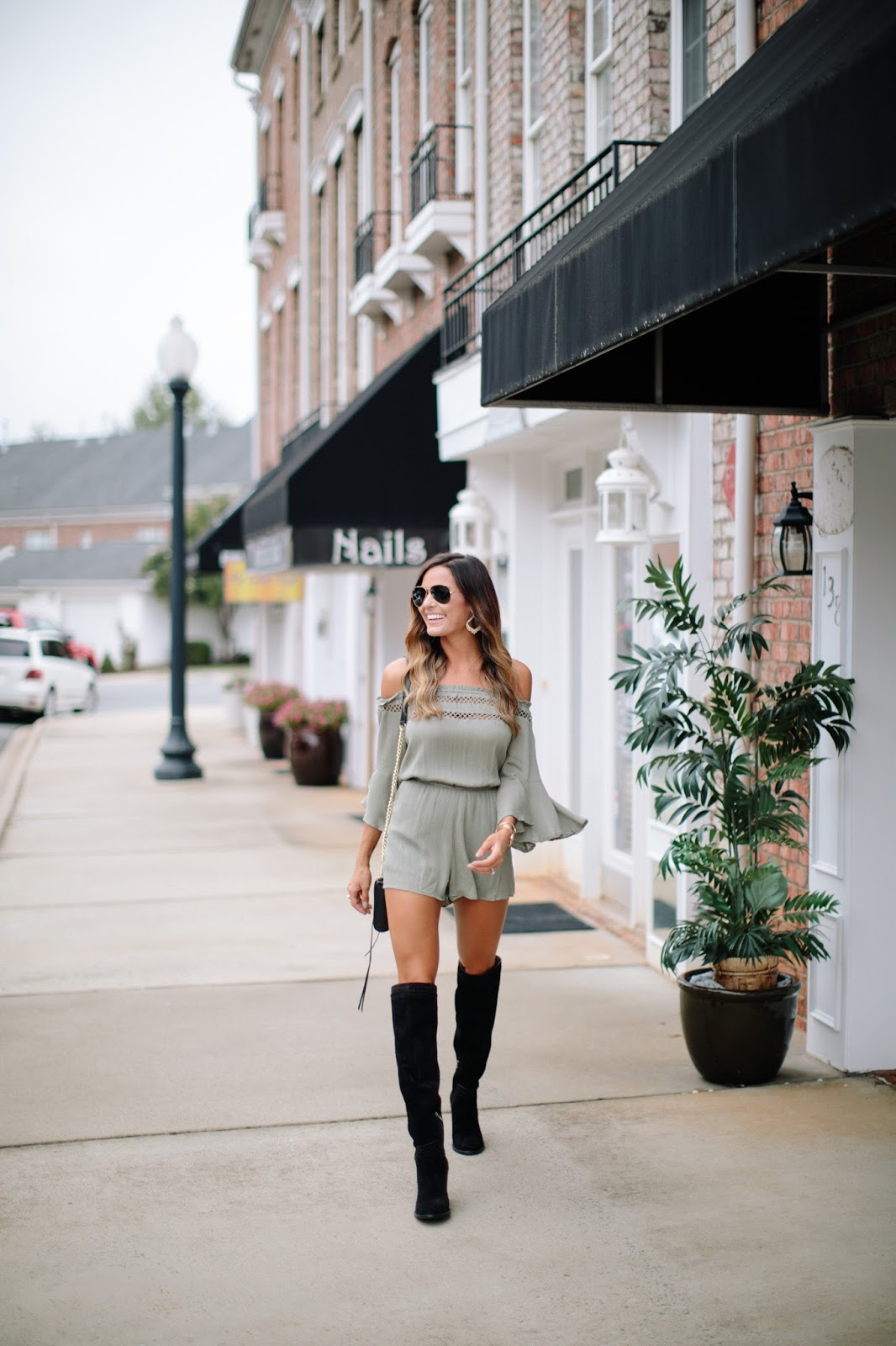 romper with black knee high boots