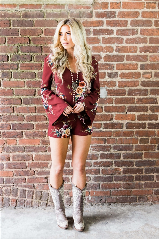 floral print romper with cowboy boots