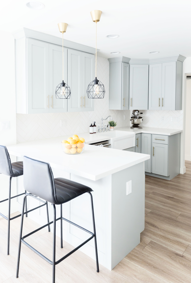 beautiful grey blue kitchen cabinets with gold hardware