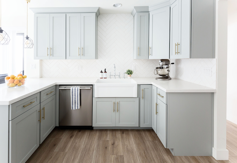 grey kitchen cabinets with gold hardware white subway tile herringbone