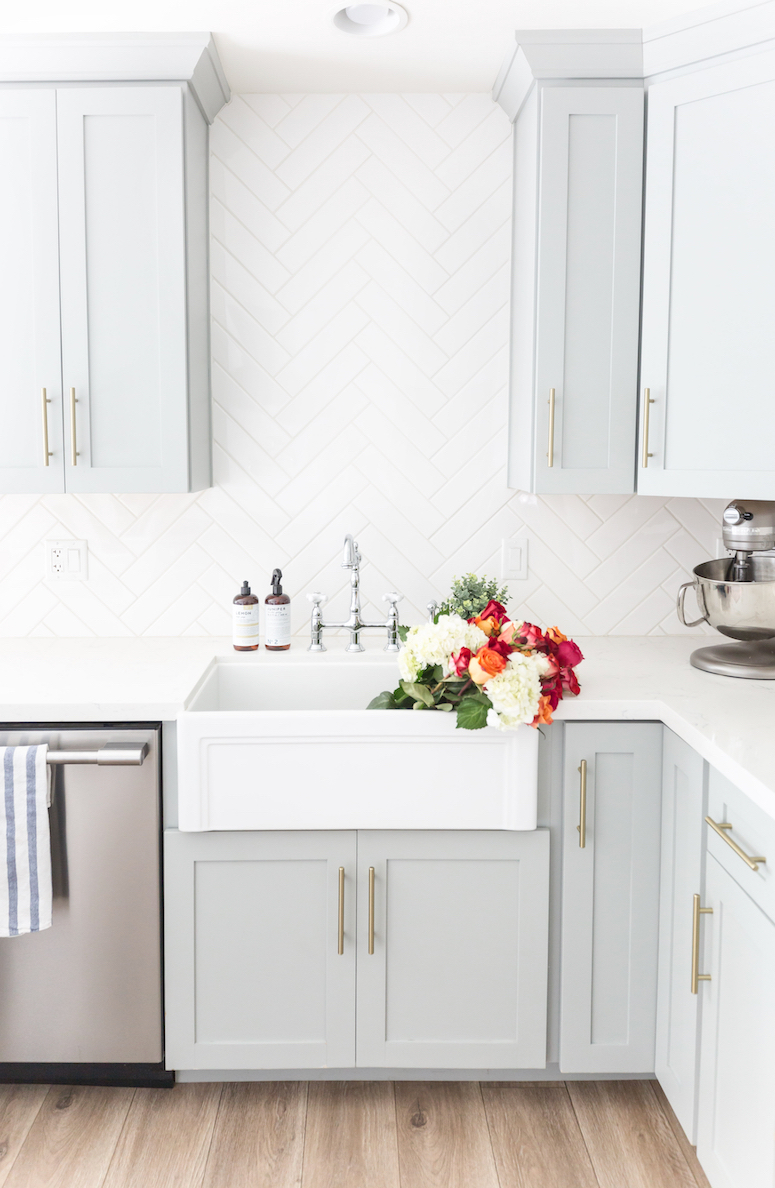farmhouse sink filled with flowers