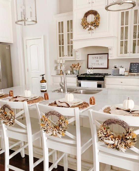 fall kitchen wreath above stove and on chairs
