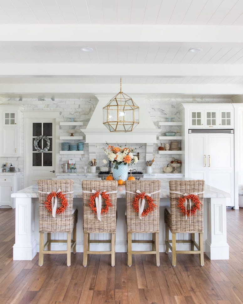 fall kitchen decor wreaths on chairs in island