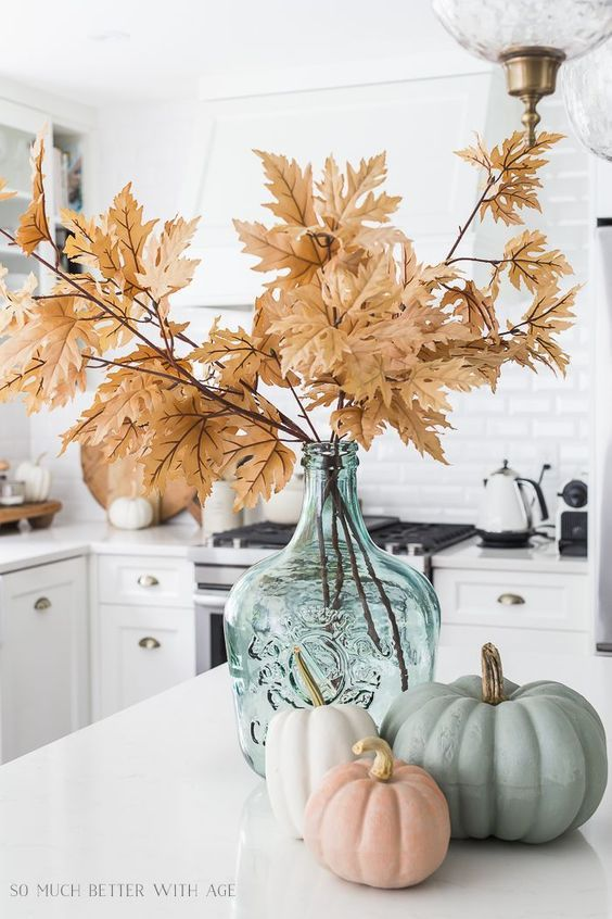 kitchen island decor for fall foiage and pumpkins