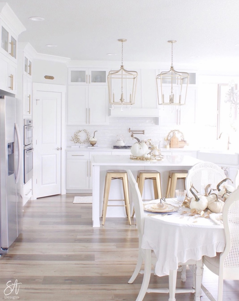 white gold and glam pumpkins in kitchen