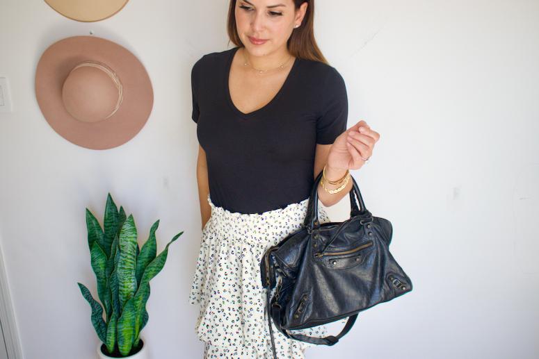 black t-shirt with skirt outfit and Balenciaga city bag