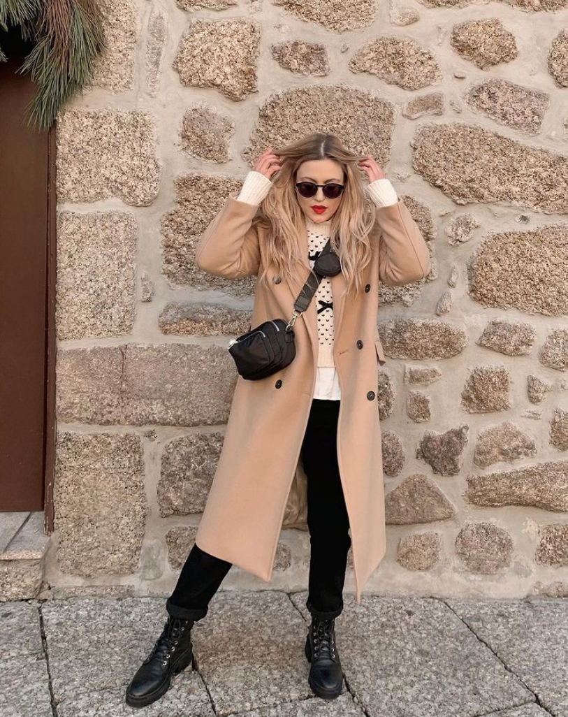 combat boots with black pants and wool coat