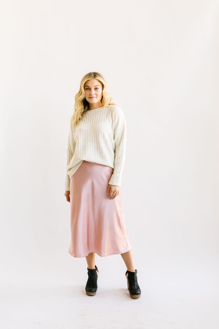 outfits with pink skirts: satin skirt with sweater and ankle boots