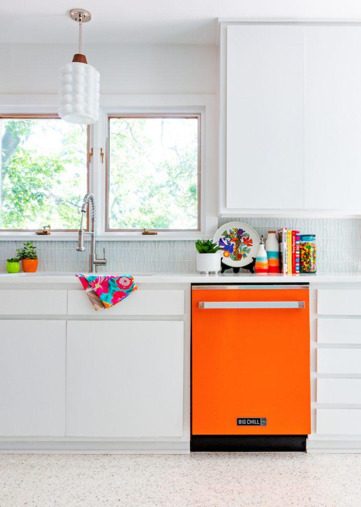 white kitchen cabinets with aqua backsplash and bright appliances
