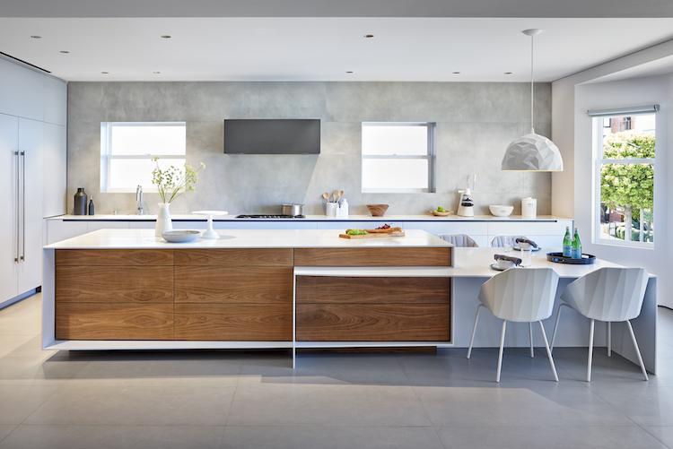 modern white kitchen with concrete backsplash