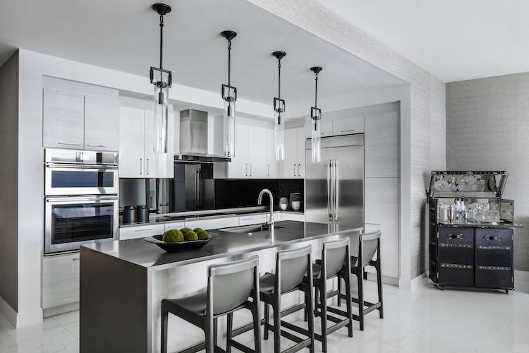 white kitchen cabinets with black backsplash