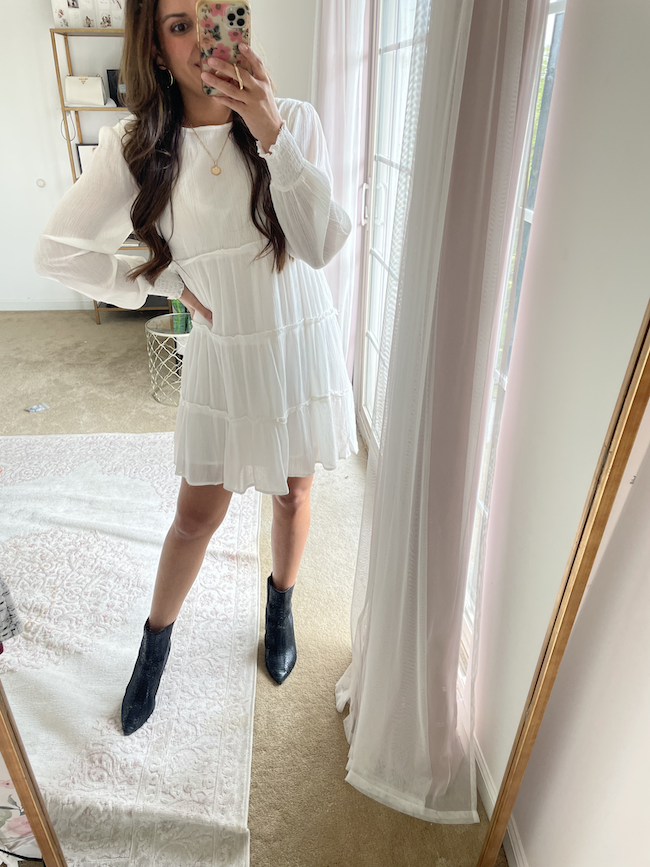 white dress for fall outfit with black ankle boots